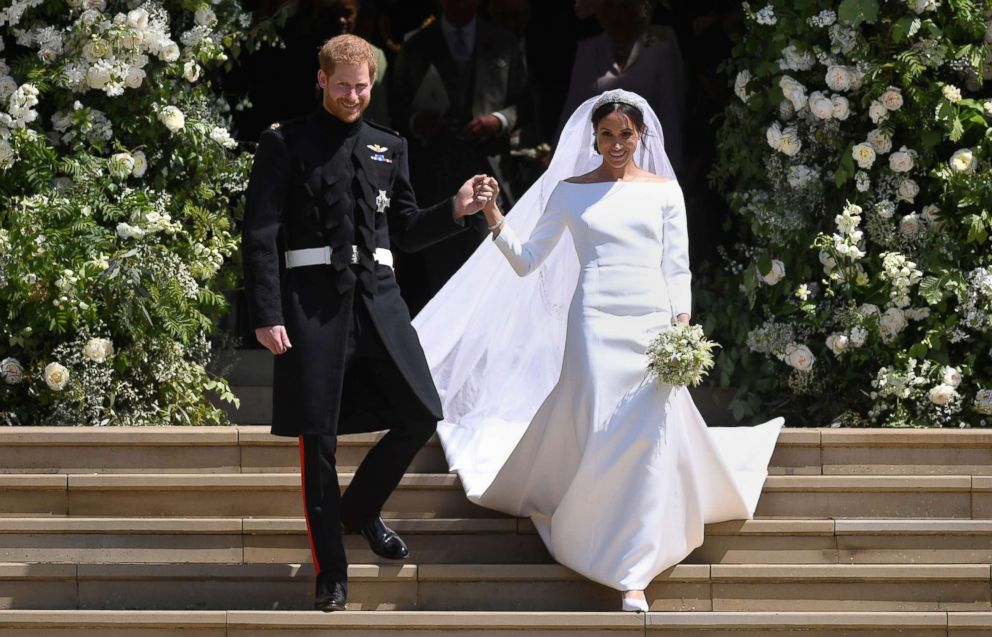 PHOTO: Britains Prince Harry, Duke of Sussex and Meghan, Duchess of Sussex, exit St. Georges Chapel at Windsor Castle after their royal wedding ceremony, in Windsor, England, May 19, 2018.