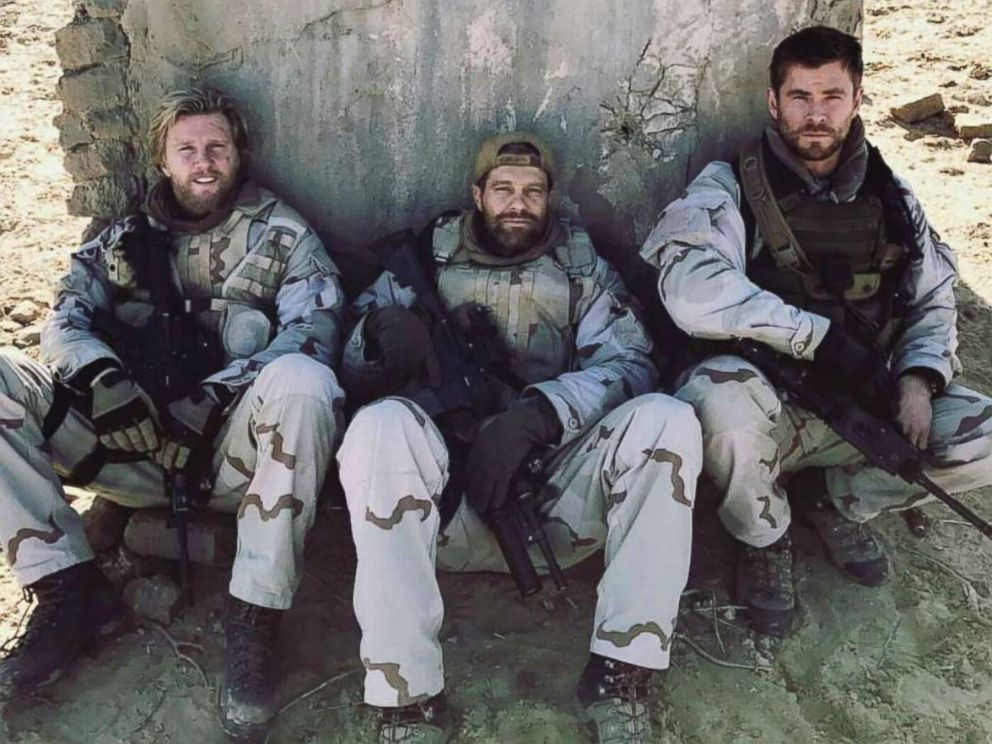 PHOTO: Jack Kesy, left, Geoff Stults, and Chris Hemsworth in Horse Soldiers.