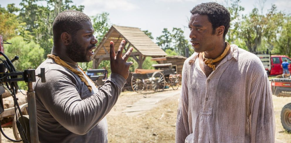 """PHOTO: In this production still, director Steve McQueen, left, and actor Chiwetel Ejiofor, right, are pictured on the set of """"12 Years a Slave."""""""
