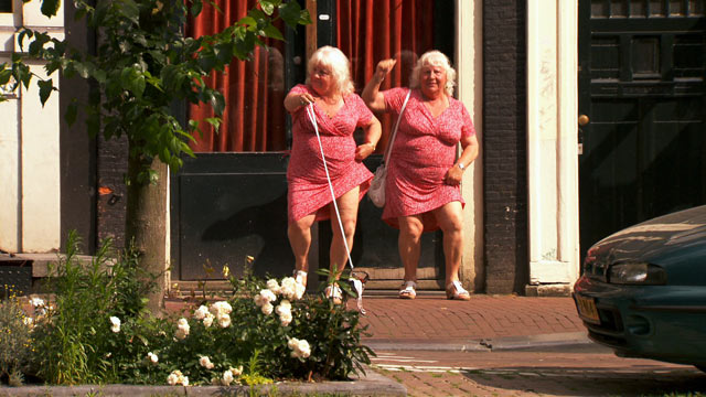 PHOTO: Louise and Martine Fokkens are two of Amsterdams beloved prostitutes and they happen to be twins with 40+ years of experience.