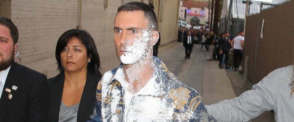 "PHOTO: Adam Levine gets powder bombed as he greets fans at ""Jimmy Kimmel Live!"" in Hollywood, Calif. on May 6, 2015."