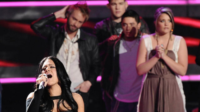 """PHOTO Pia Toscano sings her final song after learning she was voted off """"American Idol,"""" April 7, 2011."""