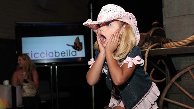 """PHOTO:""""Toddlers and Tiaras"""" star Eden Wood modeled boots from Ciccibellas Cowgirl Riders line at New York Citys Bryant Park Hotel on Sept. 15, 2011."""