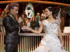 PHOTO: Stanley Tucci, as Caesar Flickerman, and Jennifer Lawrence, as Katniss Everdeen, star in the film The Hunger Games: Catching Fire.