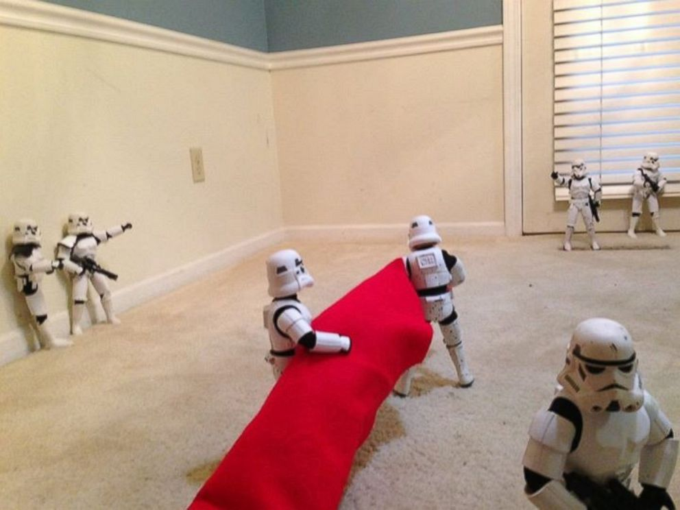 PHOTO: Father and son Phil and Kyle Shearrer enlisted the help of Star Wars stormtrooper figurines to assemble the family Christmas tree.