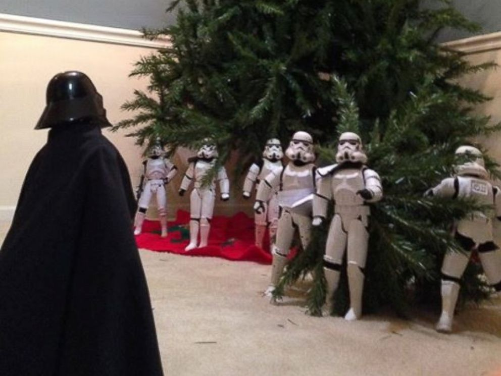 Christmas Tree Setup.Family Uses Star Wars Stormtroopers To Help Decorate For