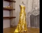 PHOTO: Zac Posen designed a gold dress worth $1.5 million inspired by Magnum Gold ice cream.