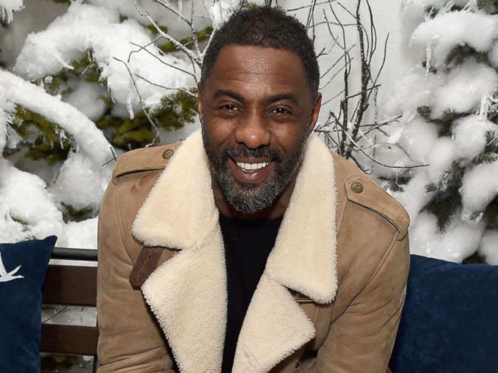Idris Elba proposes to model Sabrina Dhowre on stage at London screening