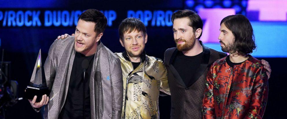 PHOTO: Dan Reynolds, Ben McKee, Daniel Platzman, and Wayne Sermon of Imagine Dragons accept the American Music Award onstage at Microsoft Theater, Nov. 19, 2017, in Los Angeles.