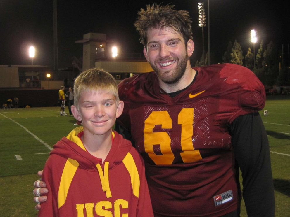 PHOTO: Jake Olson poses for a photo with former USC Trojan Kris ODowd in an undated family photo from a visit when Olson was a youngster.