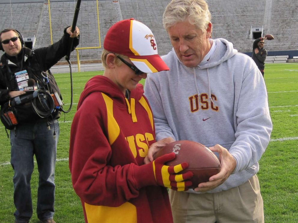 PHOTO: Jake Olson, now a long snapper for the USC Trojans, meets former USC football head coach Pete Carroll during a visit when Olson was a child.