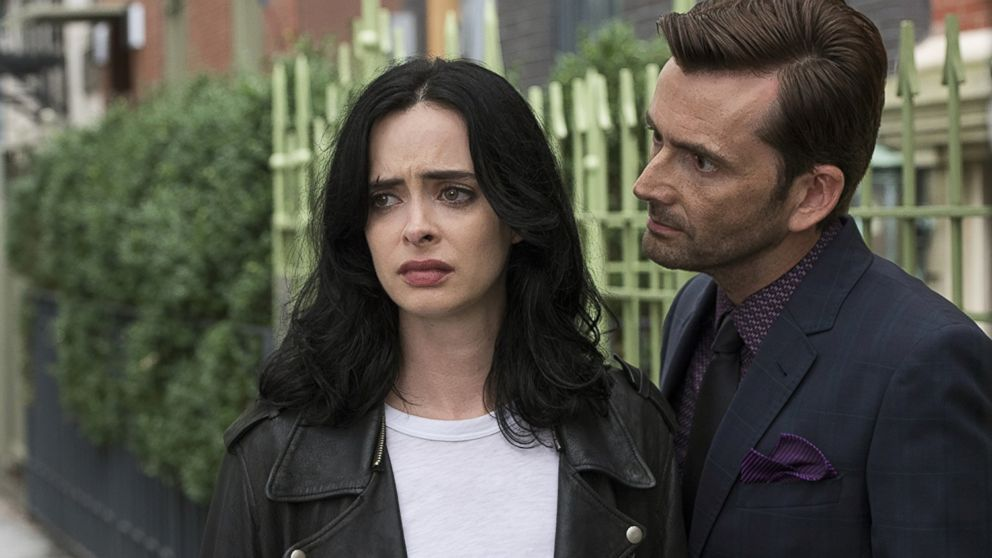 Krysten Ritter and David Tennant in Jessica Jones (2015).