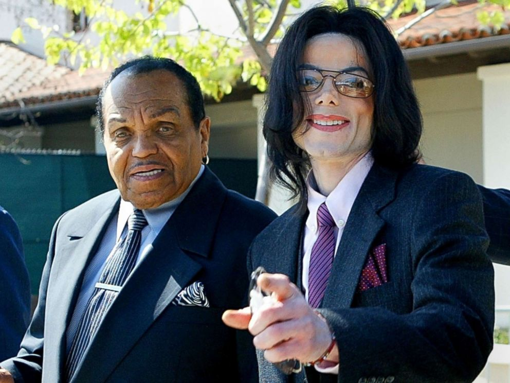 PHOTO: Singer Michael Jackson gestures as he and his father, Joseph Jackson, depart the Santa Maria Superior Court during the second week of Michaels child molestation trial March 8, 2005 in Santa Maria, Calif.
