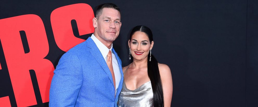 "In this Tuesday, April 3, 2018, photo, John Cena, left, and Nikki Bella attend the LA Premiere of ""Blockers"" at the Regency Village Theatre in Los Angeles."