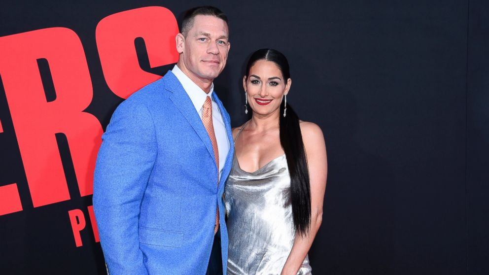 "In this Tuesday, April 3, 2018, photo, John Cena, left, and Nikki Bella attend the LA Premiere of ""Blockers"" at the Regency Village Theatre in Los Angeles. On Sunday, April 15, 2018, Bella tweeted that she and Cena have ended their engagement, saying that they've made the mutual decision to break up after six years together."