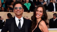 John Stamos, left, and Caitlin McHugh arrive at the Screen Actors Guild Awards on Jan. 21, 2018. Stamos announced on Instagram the birth of his son, Billy Stamos.