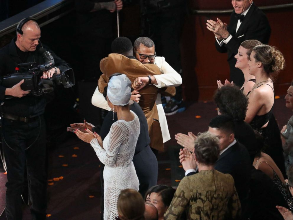 PHOTO: Jordan Peele hugs Daniel Kaluuya after winning the Oscar for best original screenplay for Get Out during the 90th Academy Awards at the Dolby Theater in Los Angeles, March 4, 2018.