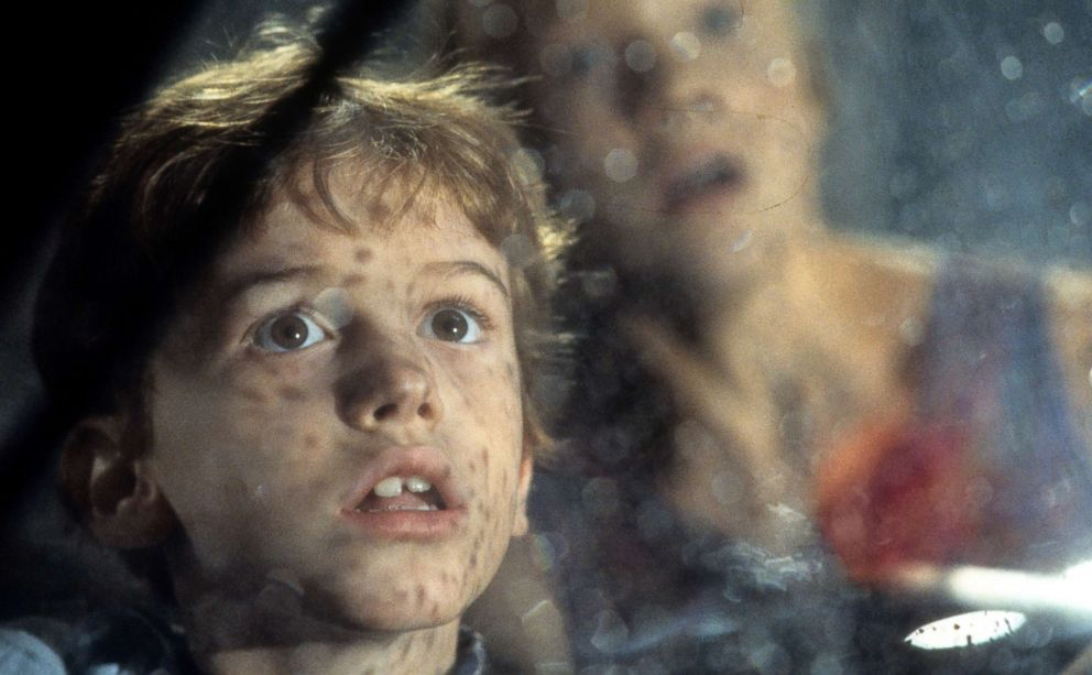 PHOTO: Joseph Mazzello and Ariana Richards look out a window in a scene from the film Jurassic Park, 1993.