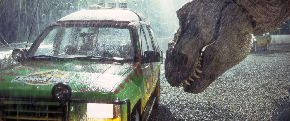 PHOTO: A Tyrannosaurus Rex menaces the theme parks first customers in a scene from the film Jurassic Park, 1993.