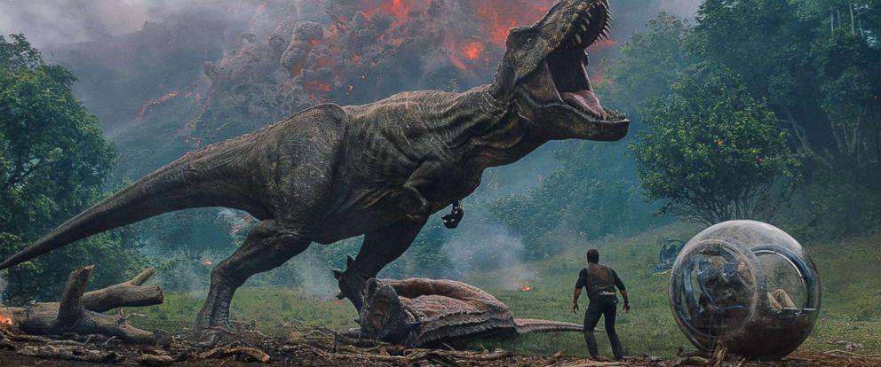 """PHOTO: Chris Pratt meets a T. rex in the film, """"Jurassic World: Fallen Kingdom."""""""