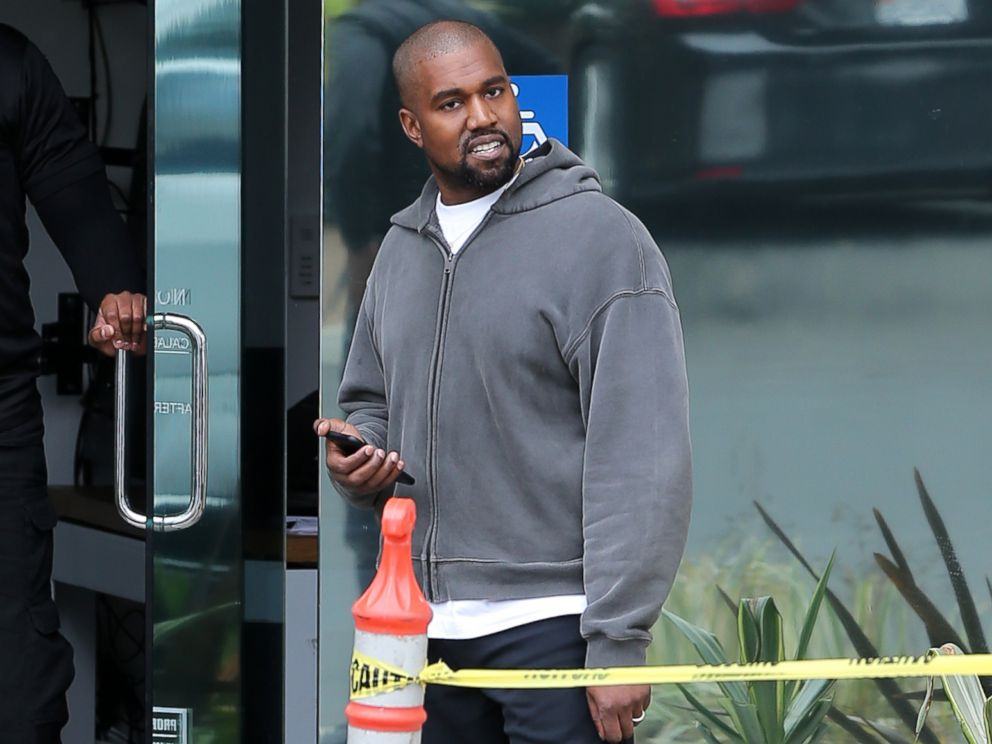 PHOTO: Kanye West pauses while walking back to his office in Los Angeles, May 1, 2018.