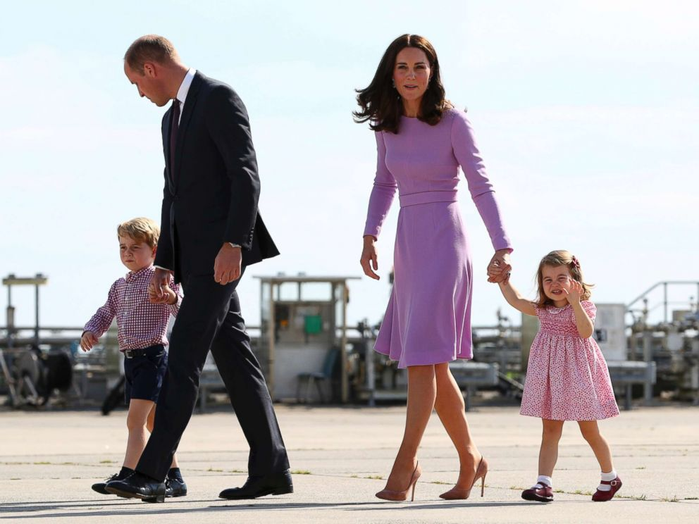 PHOTO: Britains Prince William and his wife Kate, the Duchess of Cambridge, and their children, Prince George and Princess Charlotte, are pictured before boarding a plane in Hamburg, Germany, July 21, 2017.