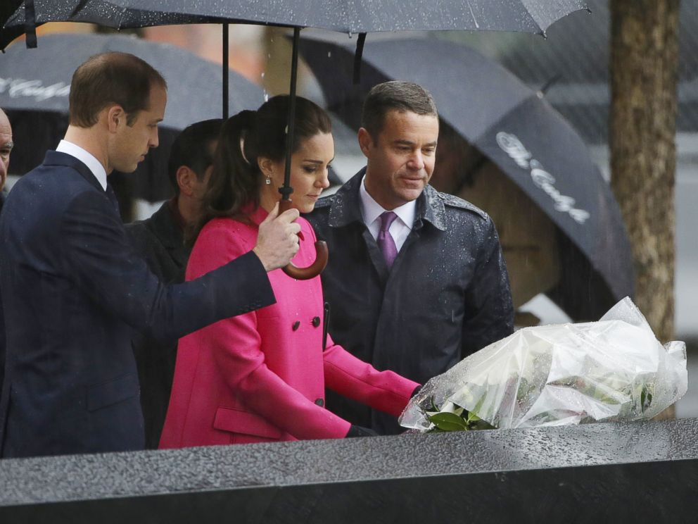 PHOTO: Britains Prince William, left, and Joe Daniels, president of the 9/11 Memorial, right, look on, as Kate, Duchess of Cambridge, lays flowers at the edge of a memorial pool at the National Sept.11 Memorial in New York, Dec. 9, 2014.