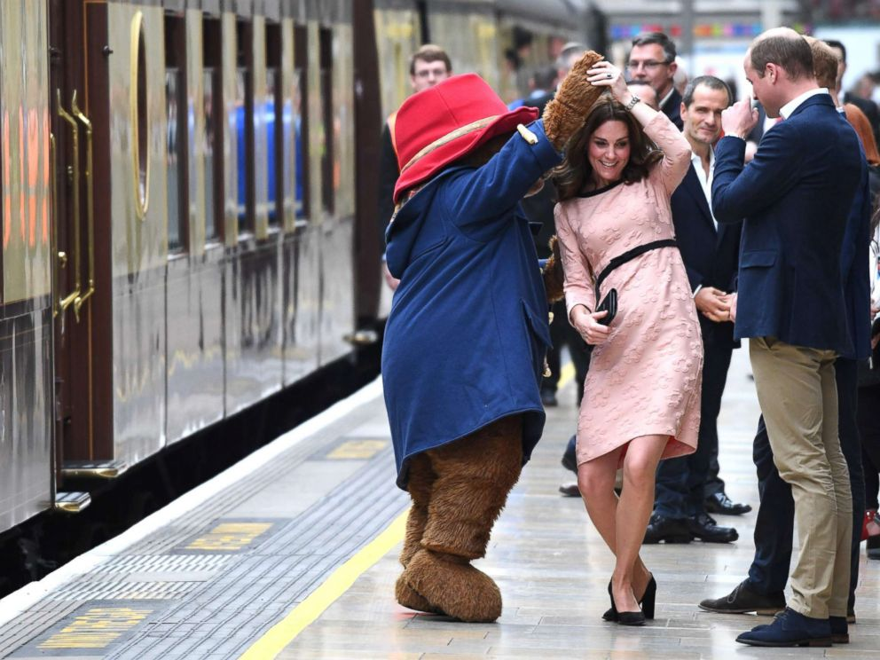 PHOTO: Britains Catherine, Duchess of Cambridge, dances with a person in a Paddington Bear outfit by her husband Britains Prince William, Duke of Cambridge as they attend a charities forum event at Paddington train station in London, Oct. 16, 2017.