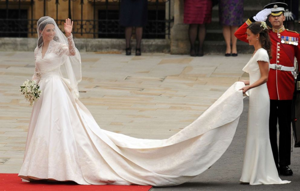 PHOTO: Kate Middleton waves as she arrives with her sister, the Maid of Honor Philippa (Pippa) Middleton at the West Door of Westminster Abbey in London for her wedding to Britains Prince William, April 29, 2011.