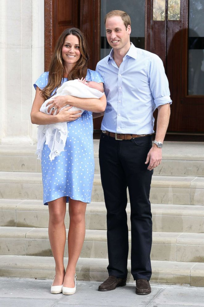 PHOTO: Prince William, Duke of Cambridge, Catherine, Duchess of Cambridge and their newborn son George depart St. Marys Hospital on July 23, 2013 in London.