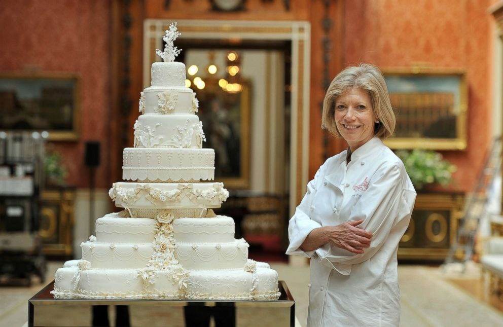 PHOTO: Fiona Cairns stands next to the Royal Wedding cake that she and her team made for Prince William and Kate Middleton in London, April, 29, 2011.