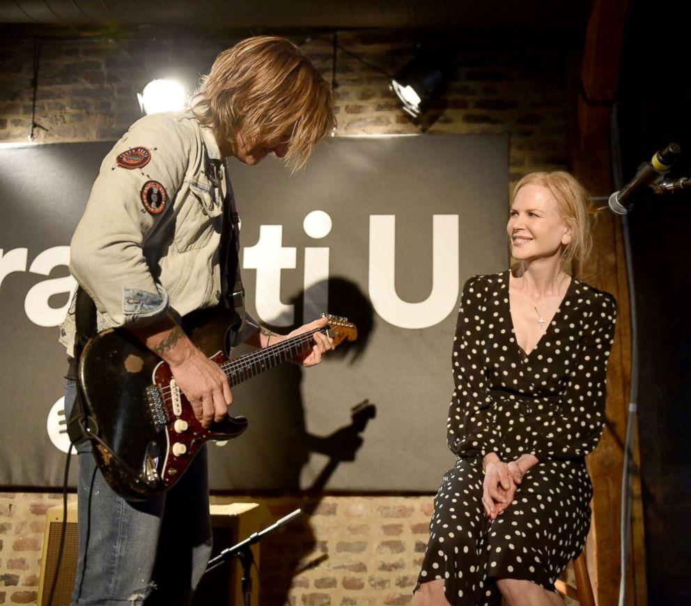 PHOTO: Keith Urban and wife Nicole Kidman perform onstage for a spotify fans first event at Houston Station, April 23, 2018, in Nashville, Tenn.