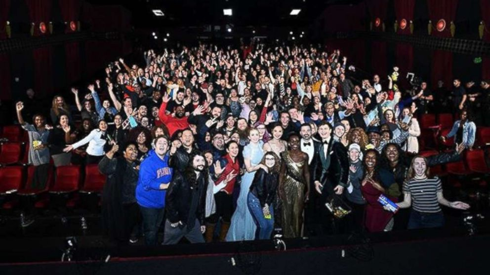 An audience at a movie theater nearby gets a surprise visit from Oscar host Jimmy Kimmel and other actors and actresses, March 4, 2018, in Los Angeles.