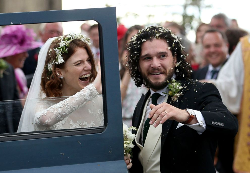 PHOTO: Kit Harington and Rose Leslie react as they leave after their wedding ceremony, at Rayne Church, Kirkton of Rayne in Aberdeenshire, Scotland, June 23, 2018.