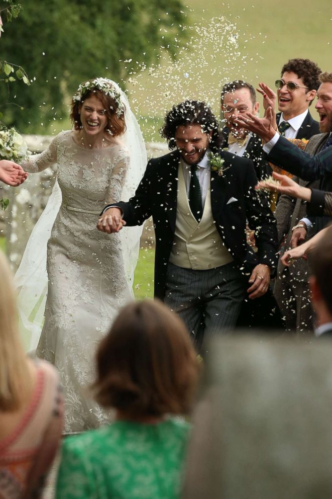 PHOTO: Kit Harington and Rose Leslie react as they leave after their wedding ceremony at Rayne Church, Kirkton of Rayne in Aberdeenshire, Scotland, June 23, 2018.
