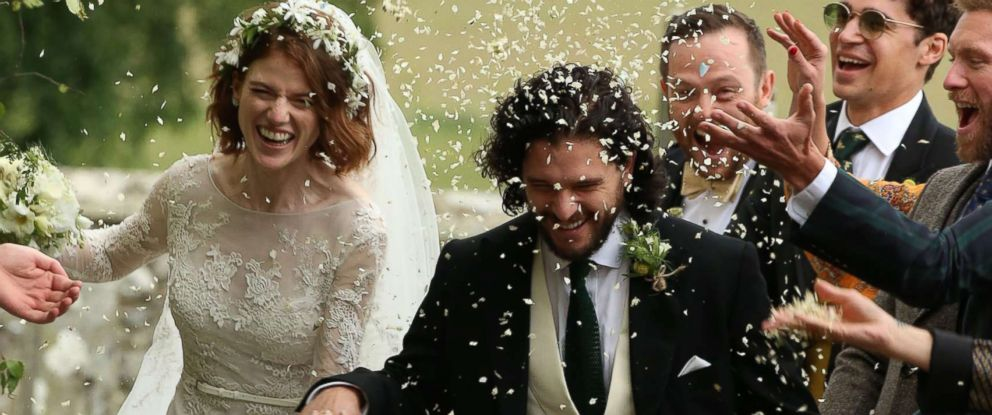 PHOTO: Kit Harington and Rose Leslie react as they leave after their wedding ceremony in Aberdeenshire, Scotland, June 23, 2018.