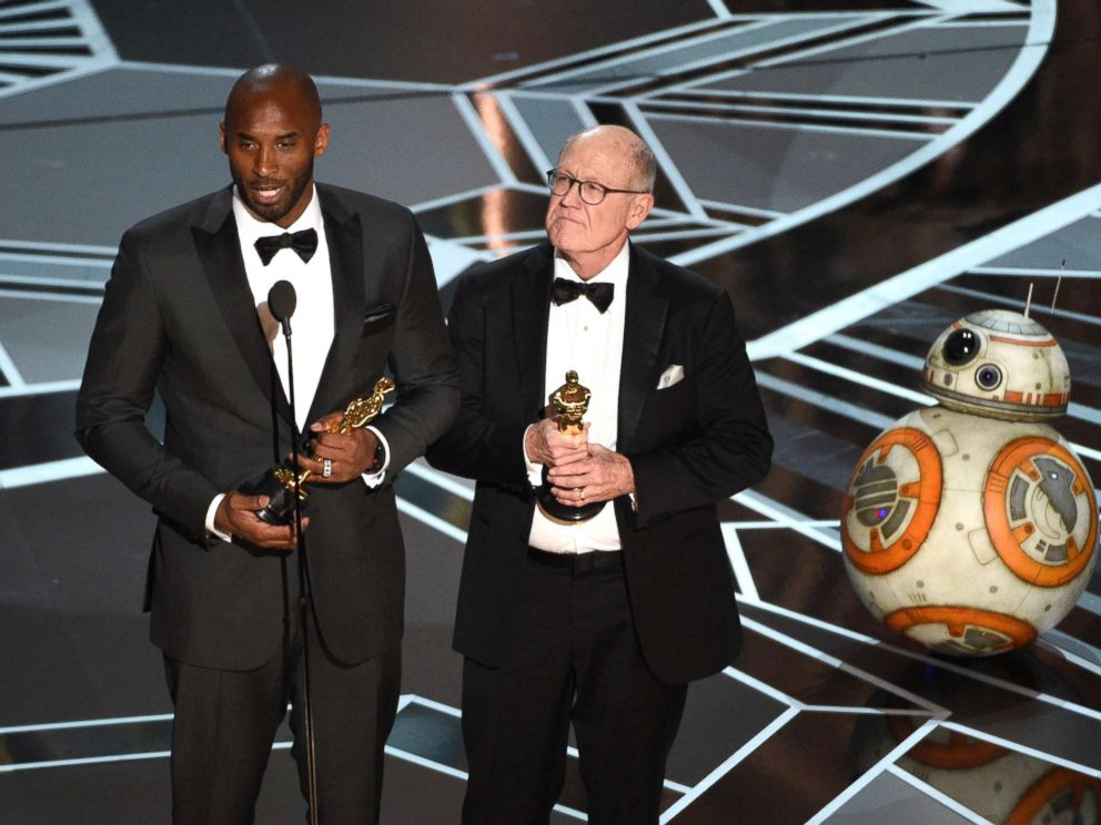 PHOTO: Kobe Bryant and Glen Keane accept the award for best animated short for Dear Basketball at the Oscars, March 4, 2018, at the Dolby Theatre in Los Angeles. BB-8 appears at right.