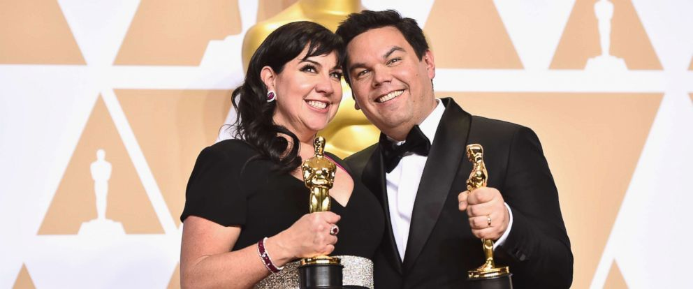 PHOTO: Composers Kristen Anderson-Lopez and Robert Lopez, winners of the Best Original Song award for Remember Me from Coco, pose in the press room during the 90th Annual Academy Awards, March 4, 2018, in Hollywood, Calif.