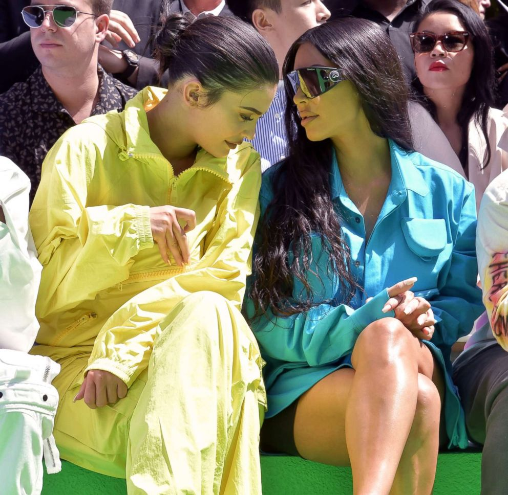 PHOTO: Kylie Jenner and Kim Kardashian sit in the front row at a Louis Vuitton show in Paris, June 21, 2018.