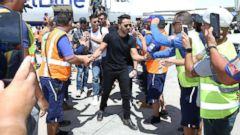 'PHOTO: Luis Fonsi, Ricky Martin and other Latin celebrities greet JetBlue crew members upon arrival1_b@b_1Luis Munoz Marin International Airport in San Juan, Puerto Rico, on, Oct. 2, 2017.' from the web at 'https://s.abcnews.com/images/Entertainment/luis-fonsi-ap-02-jpo-171213_16x9t_240.jpg'