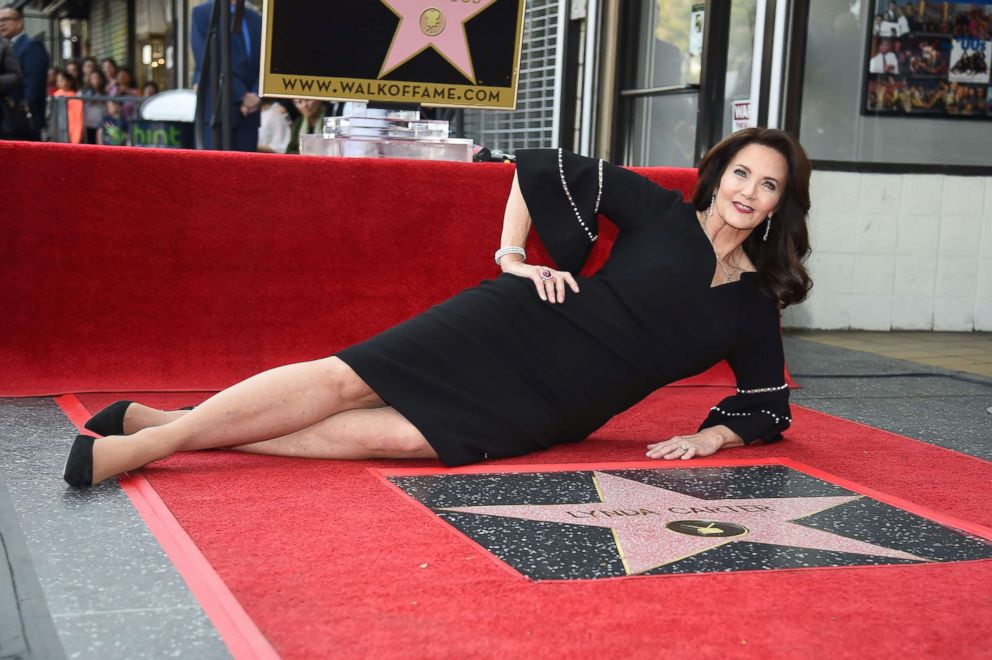 PHOTO: Actress Lynda Carter poses on her star on the Hollywood Walk of Fame at the star unveiling ceremony, April 3, 2018, in Hollywood, Calif.