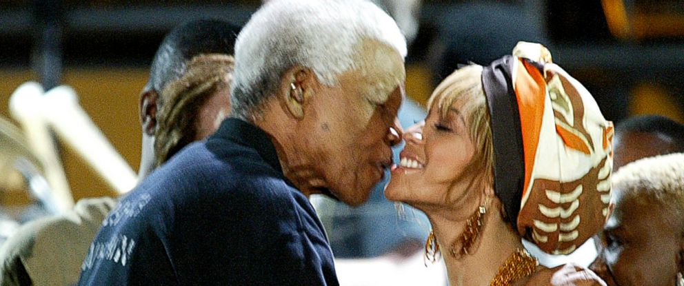 PHOTO: Former South African President Nelson Mandela, kisses Beyonce Knowles, at the Nelson Mandela AIDS Benefit Concert in Cape Town, South Africa, Nov. 29, 2003.