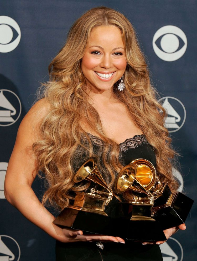 PHOTO: Singer Mariah Carey poses with her Best Female R&B Vocal Performance, Best Contemporary R&B Album and Best R&B Song awards in the press room at the 48th Annual Grammy Awards at the Staples Center in this Feb. 8, 2006 file photo in Los Angeles.