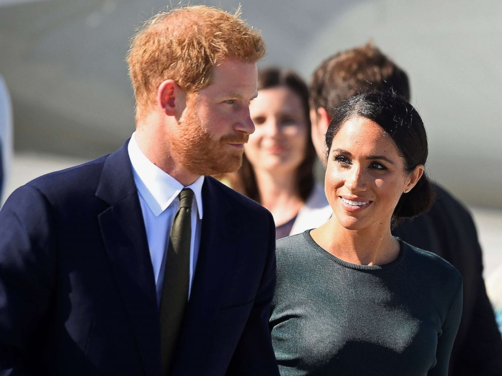 PHOTO: Britains Prince Harry and Meghan Markle, the Duke and Duchess of Sussex, arrive at the airport for a two-day visit to Dublin, July 10, 2018.