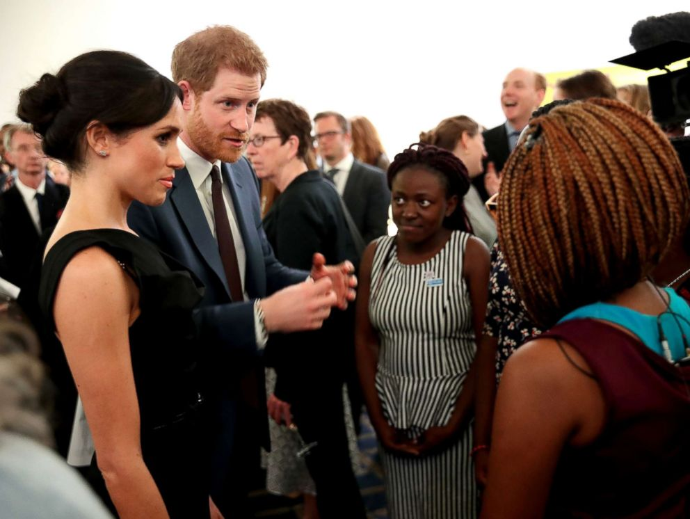 PHOTO: Meghan Markle and Prince Harry speaks with guests as they attend the Womens Empowerment reception at the Royal Aeronautical Society, April 19, 2018, in London.
