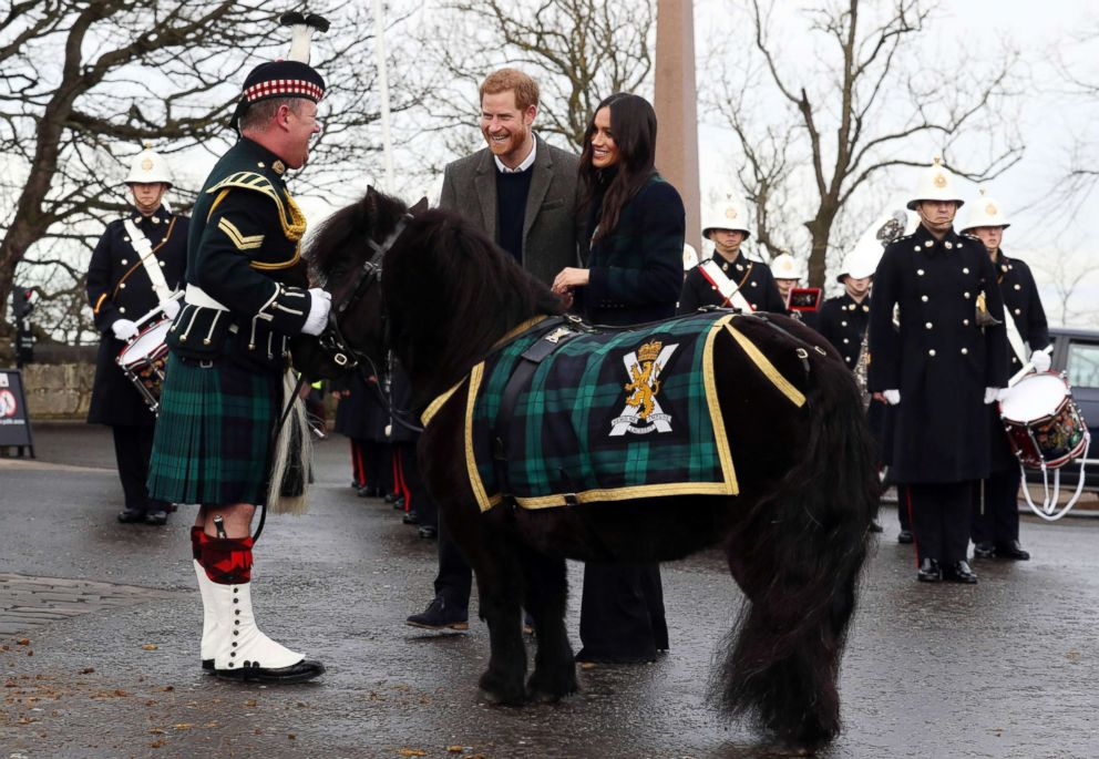 PHOTO: Britains Prince Harry and Meghan Markle meet Pony Major Mark Wilkinson and regimental mascot Cruachan IV on the esplanade at Edinburgh Castle, Scotland, Feb. 13, 2018.