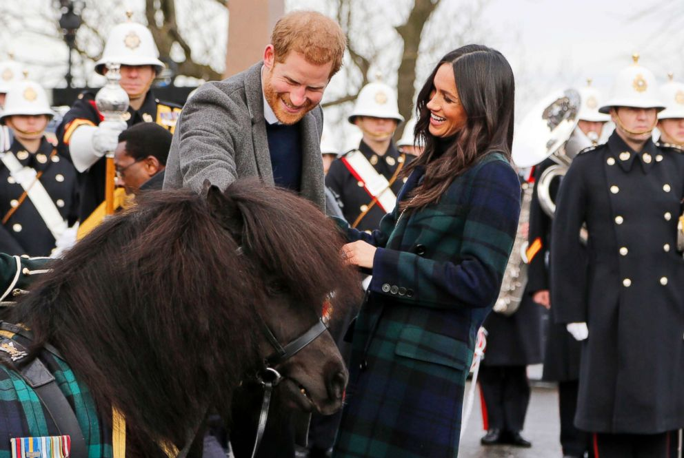 PHOTO: Britains Prince Harry and his fiancee Meghan Markle meet a Shetland Pony as they arrive at Edinburgh Castle in Edinburgh, Scotland, Feb. 13, 2018.