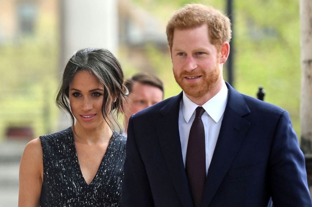 PHOTO: Britains Prince Harry and Meghan Markle arrive to attend a memorial service at St Martin-in-the-Fields in Trafalgar Square in London, on April 23, 2018, to commemorate the 25th anniversary of the murder of Stephen Lawrence.