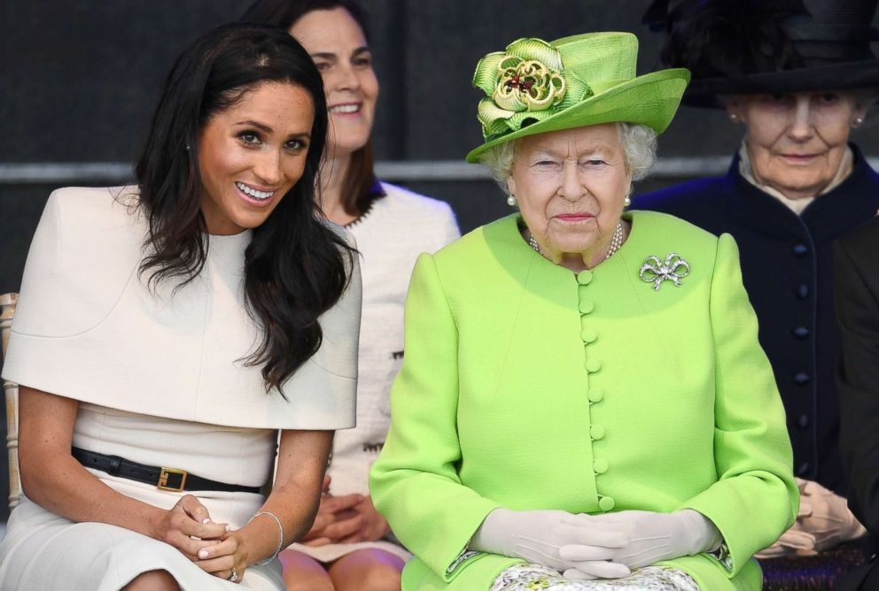 PHOTO: Meghan, Duchess of Sussex and Queen Elizabeth II laugh during a ceremony to open the new Mersey Gateway Bridge, June 14, 2018, in the town of Widnes in Halton, Cheshire, England.