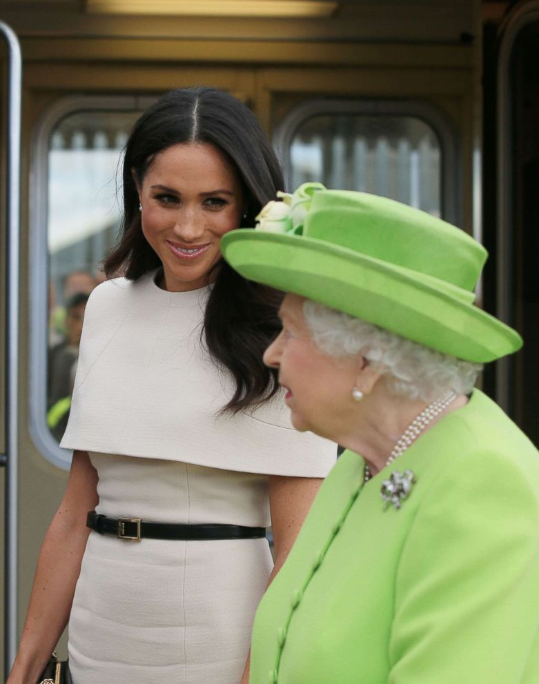 PHOTO: Queen Elizabeth II and Meghan, Duchess of Sussex arrive by Royal Train at Runcorn Station to open the new Mersey Gateway Bridge, June 14, 2018, in the town of Runcorn, Cheshire, England.